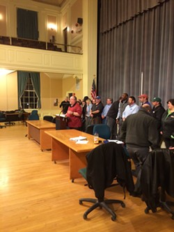 CCTA bus driver Mike Walker speaks to the crowd inside Burlington City Hall Auditorium on Thursday night. - MARK DAVIS
