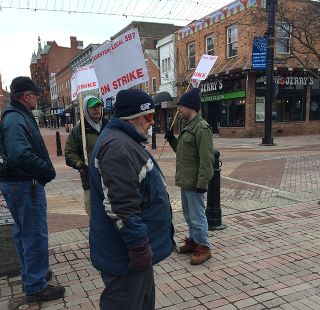 Chittenden County Transportation Authority bus drivers picketing at Church and Cherry streets Friday - MARK DAVIS
