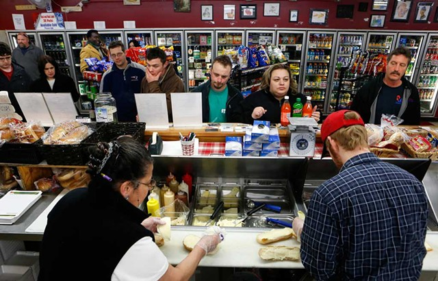 Christine Alvanos and a Pine Street Deli employee handle the lunch rush on Friday