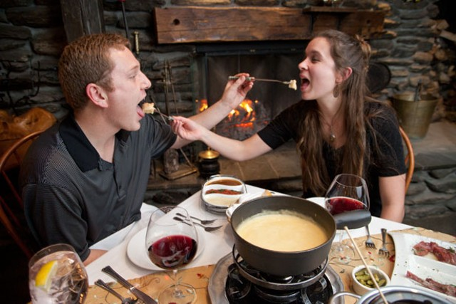 Chuck and Kristen Vella enjoying fondue at Emily's at Stowehof Inn & Resort - MATTHEW THORSEN