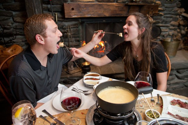 Chuck and Kristen Vella enjoying fondue at Emily's at Stowehof Inn & Resort - MATTHEW THORSEN