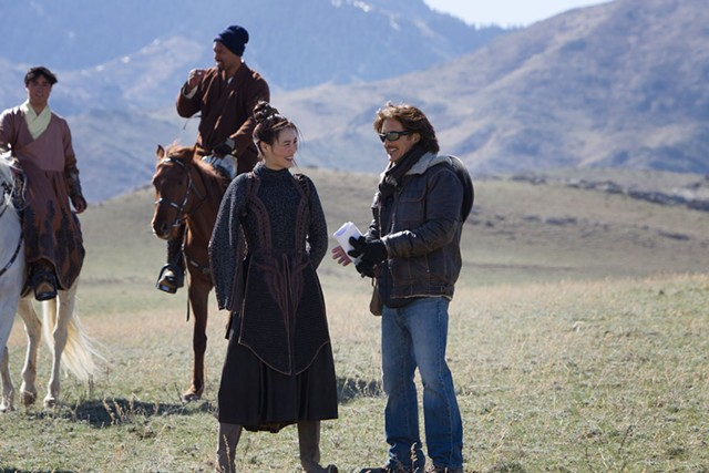 "Claudia Kim (left) with John Fusco  on the set of ""Marco Polo"" - COURTESY OF PHIL BRAY FOR NETFLIX"
