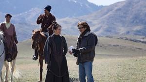 "Claudia Kim (left) with John Fusco  on the set of ""Marco Polo"""
