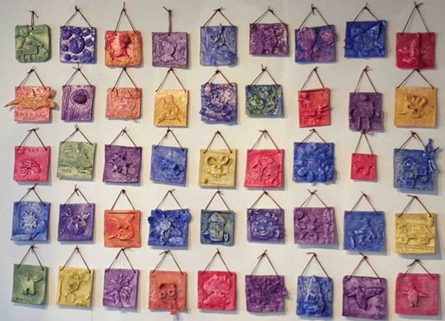 Clay relief tiles by IAA kindergarten students, with BCA teaching artist Kim Desjardins - XIAN CHIANG-WAREN