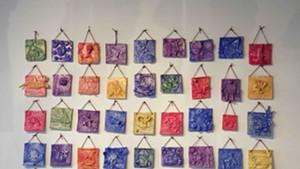 Clay relief tiles by IAA kindergarten students, with BCA teaching artist Kim Desjardins