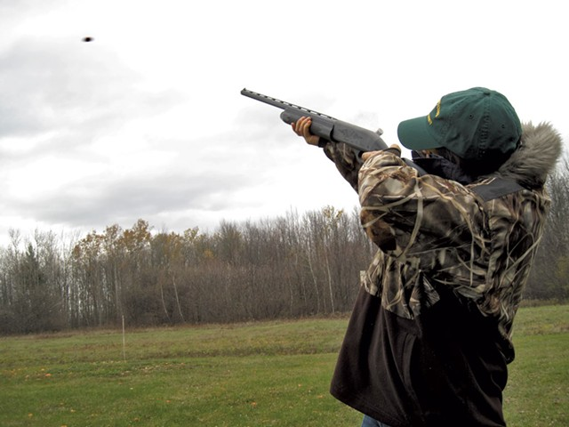 Courtney Copp takes aim at a clay pigeon - ETHAN DE SEIFE