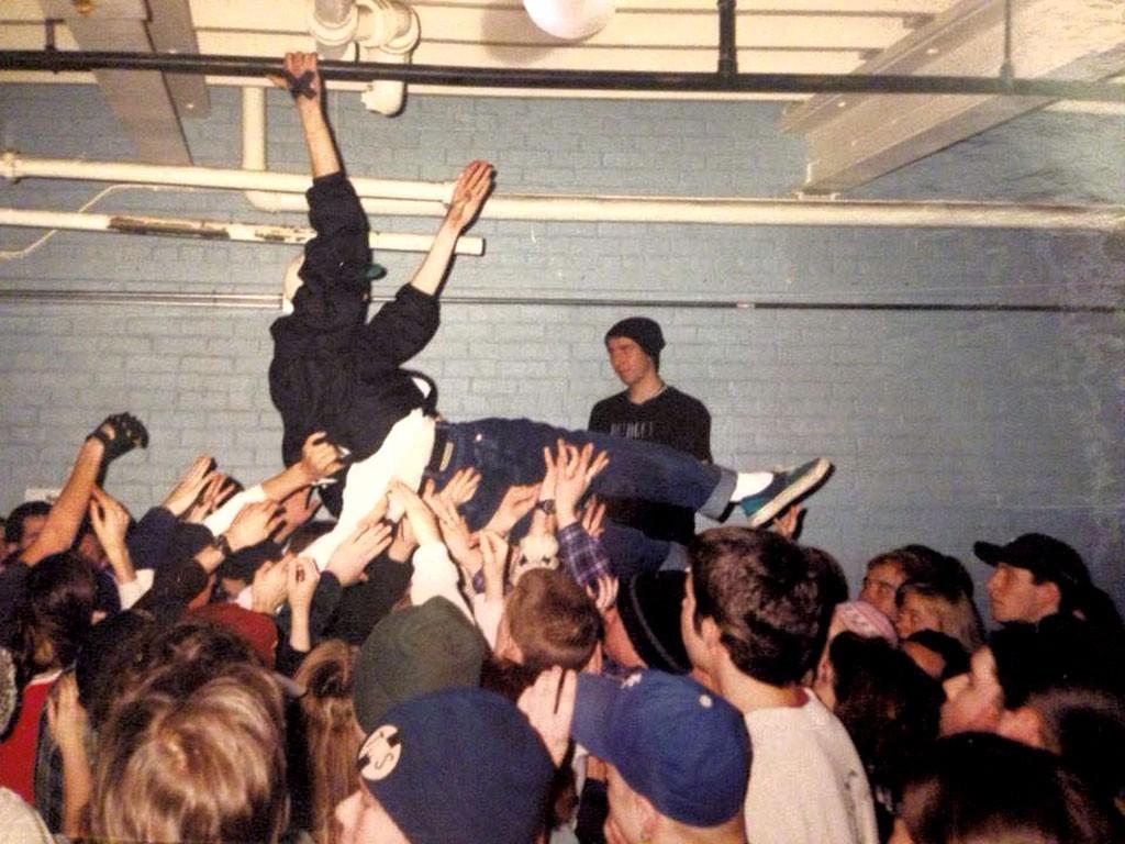 Crowd-surfing, 1995 - COURTESY OF JOE HARIG