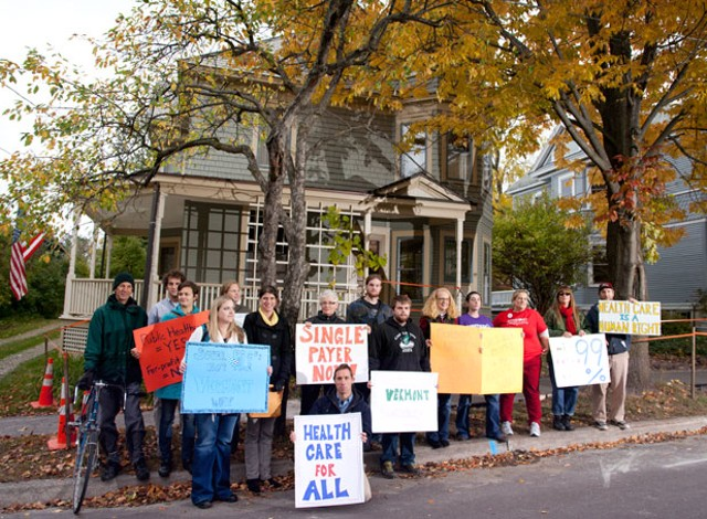 Demonstrators outside Broughton's Burlington home