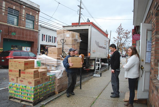 Donna Taylor and two volunteers unload a delivery at a Rutland food shelf.