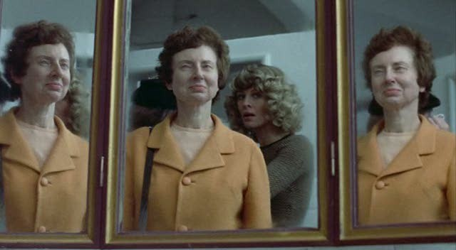 Don't Look Now complicates vision in many ways, as demonstrated by this multi-mirror shot. - PARAMOUNT PICTURES