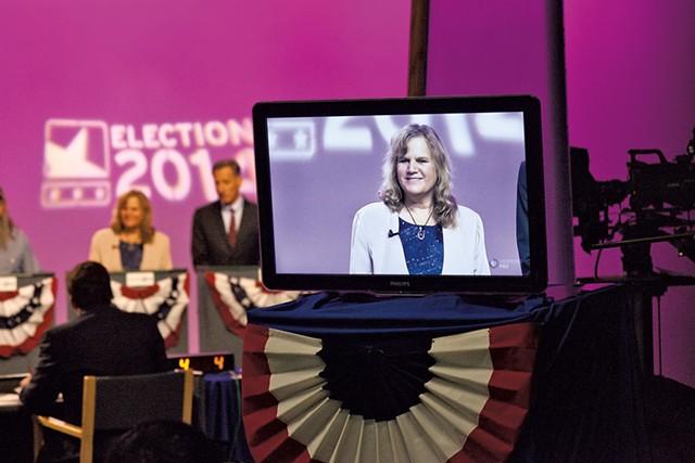 Emily Peyton with Peter Shumlin at a televised debate last Thursday - MATTHEW THORSEN