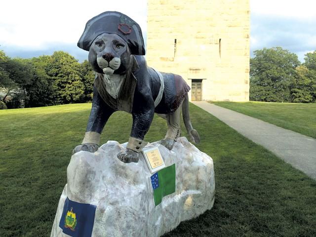 Ethan the catamount keeps watch  at the Bennington Battle Monument - ALICE LEVITT