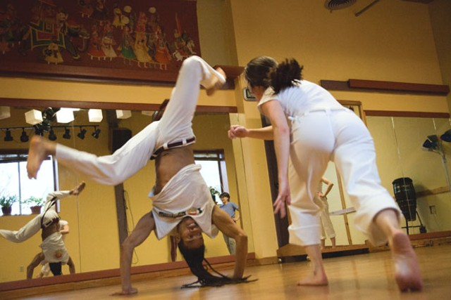 "Fabio Nascimento and a student improvise a capoeira ""fight"" - MATTHEW THORSEN"