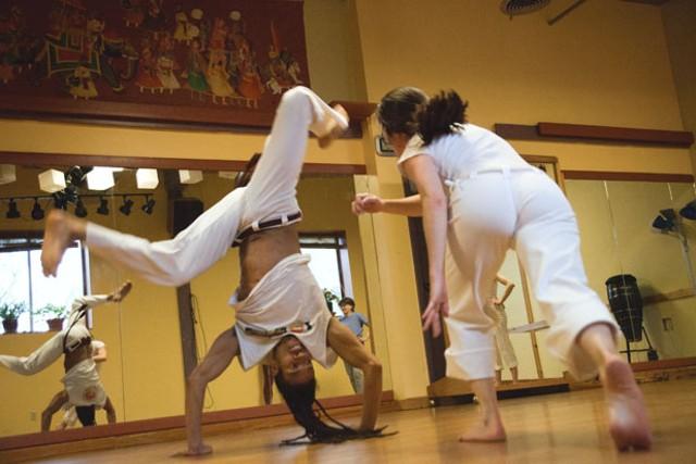 """Fabio Nascimento and a student improvise a capoeira """"fight"""" - MATTHEW THORSEN"""