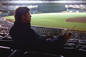 FIELD OF SCHEMES Far from the action, Pitt monitors his team and contemplates his next move in Miller's sports drama.