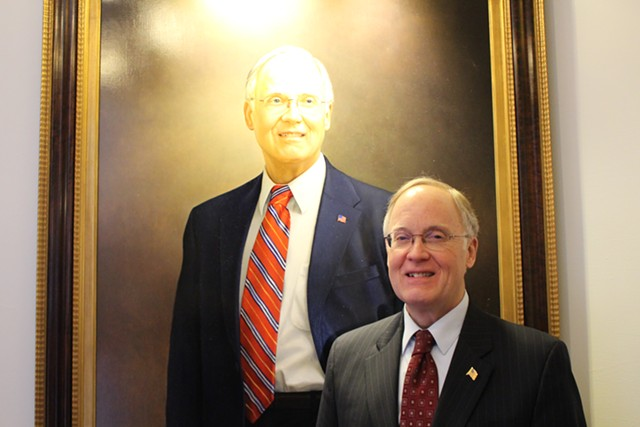 Former governor Jim Douglas and his official portrait, painted by Kate Gridley - PAUL HEINTZ