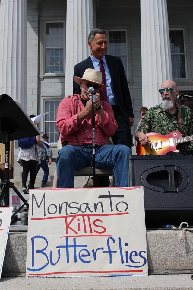 Former legislator and lobbyst Bob Stannard performs after the bill-signing ceremony. - PAUL HEINTZ