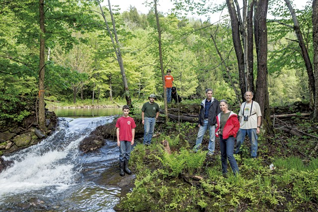 Friends of Gillett Pond from right to left: Bob Low, Nancy Stoddard,  Dan Stoddard, Bridger (dog), Colin Low, Jon Low and Teagan Low - OLIVER PARINI
