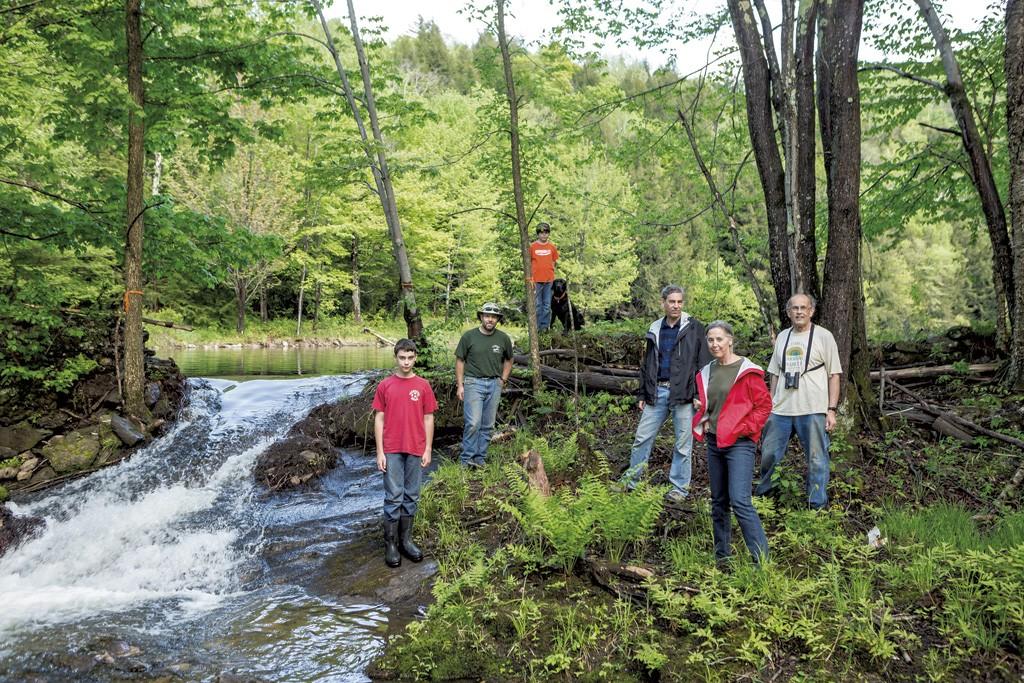 Friends of Gillett Pond from right to left: Bob Low, Nancy Stoddard,  Dan Stoddard, Bridger (dog), Colin Low, Jon Low and Teagan Low - OLIVER PARINI