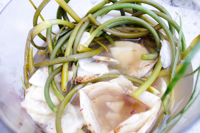 Garlic scapes and celery root hot-brined pickles. - HANNAH PALMER EGAN