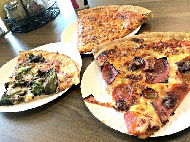 Gluten-free veggie, regular cheese and Meat Lovers' slices - ALICE LEVITT