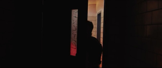 Graphic match, Shot 2: Gerry pushes through a different door. - PARAMOUNT PICTURES