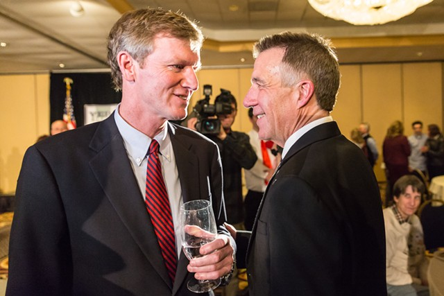 Gubernatorial candidate Scott Milne talks with Phil Scott, right, on election night. - OLIVER PARINI