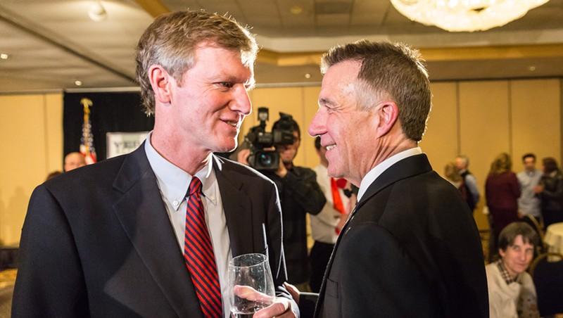 Gubernatorial candidate Scott Milne talks with Phil Scott, right, on election night.