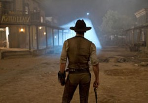 GUN FIGHT AT THE E.T. CORRAL Craig faces off with special effects from the final frontier.