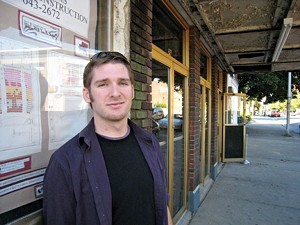Heath Powers outside the Strand Theatre