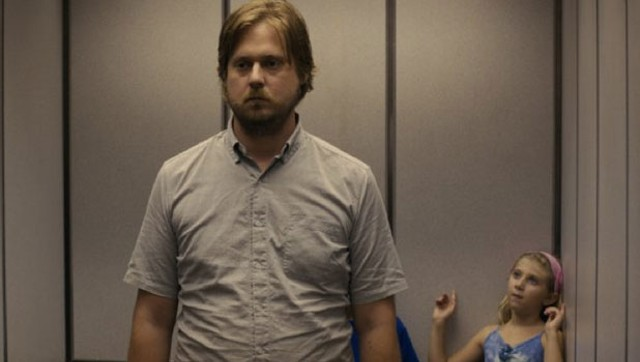 Heidecker tries to ignore someone else who doesn't take life seriously in The Comedy.