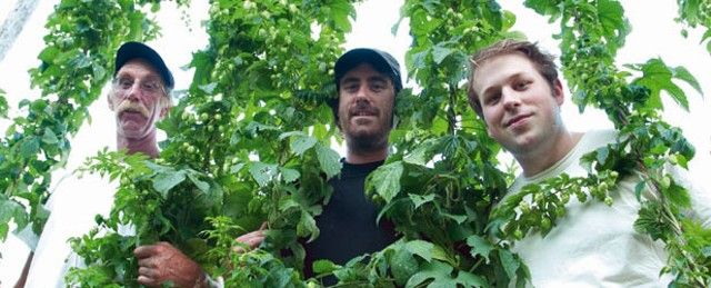 Ian Birkett, in black, his dad Joe Birkett (in glasses) and Fletcher Bach operate Square Nail Hops Farm in Ferrisburgh.