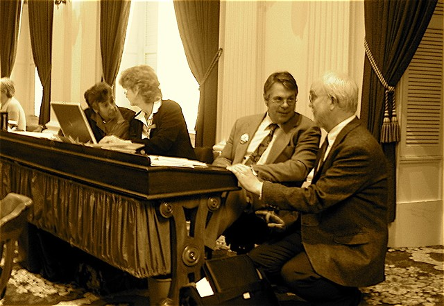 In this file photo from April 2007, then-majority whip Nease (second from right) chats with Rep. Bill Lippert (D-Hinesburg). - FILE: PETER FREYNE