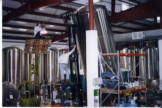 Installing equipment at the new brewery, mid-1990s. - COURTESY OF LONG TRAIL BREWING COMPANY