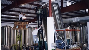 Installing equipment at the new brewery, mid-1990s.