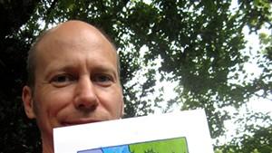James Kochalka selfie with prize painting