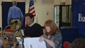 Jeanne Collins sits next to Burlington school board chair, Patrick Halladay at a recent meeting.