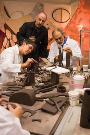 """MATTHEW THORSEN - John Brickels, center, oversees his """"scientists."""""""