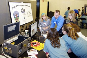 Jonathan Rajewski, digital forensics examiner, shows tools of the trade to local schoolkids.