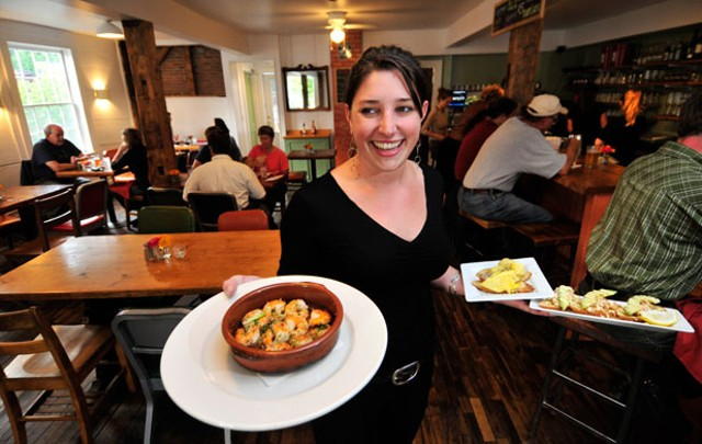 Jule Miller delivers tapas to a table - JEB WALLACE-BRODEUR