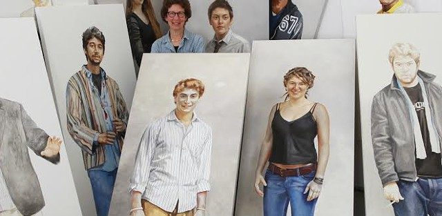 Kate Gridley surrounded by her portraits - COURTESY OF THE JACKSON GALLERY