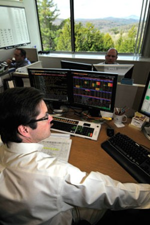 JEB WALLACE-BRODEUR - Ken Hart, corporate bond trader, in the fixed-income trading room at National Life.