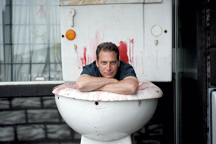 Ken Picard inside a bloody toilet statue - NATALIE WILLIAMS