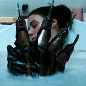 KNIFE DREAM Mara demonstrates why it's a bad  idea to doze off in the tub in a scene from this horror regurgitation — er, remake.