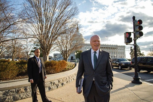 Leahy crosses the Capitol grounds with security in tow
