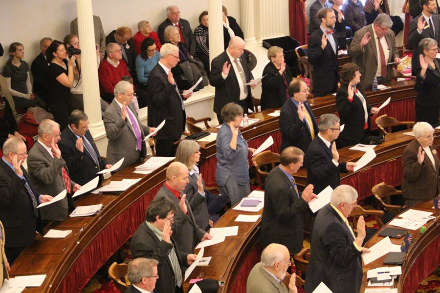 House members swear the oath of office. - PAUL HEINTZ