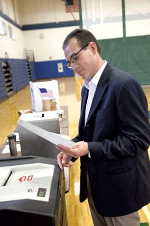 Libertarian gubernatorial candidate Dan Feliciano casts his ballot in Essex on Tuesday. - MATT THORSEN