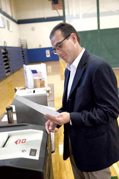 Libertarian gubernatorial candidate Dan Feliciano casts his ballot in Essex on Tuesday. - MATT THORSEN