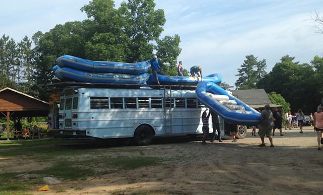 Loading rafts onto the bus - ANDREA SUOZZO