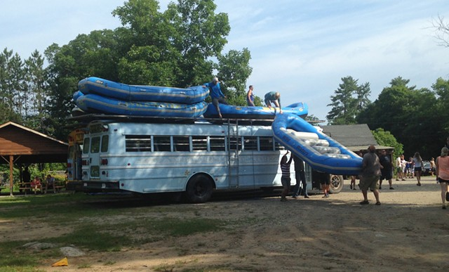 Loading rafts onto the bus - ANDREA SUOZZO